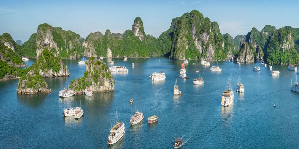 Halong Bay. A forum was underway in Halong city, the northern province of Quang Ninh, to seek measures to promote the sustainable development of green economy and tourism. The event on June 23 and 24 is organised by the Quang Ninh provincial Department of Tourism and the institute for communication and cultural studies under the Ministry of Culture, Sports and Tourism. It attracted about 200 participants, including officials of the culture, environment and foreign ministries, domestic and foreign economic experts, and businesses in the tourism industry. They discussed policies for sustainably developing economy and tourism, solutions to develop green economy and tourism, Japan's experience in the field, support for small-and medium-sized enterprises to use green production technologies, and investors and businesses' role in developing green tourism sustainably. Le Doan Hop, Director of the institute for communication and cultural studies, said green tourism helps protect the nature and culture. The development of green tourism has been generating enormous economic benefits and creating chances to increase jobs and income for local communities, especially in remote areas which are home to nature reserves and attractive landscapes. Green tourism has also helped improve people's knowledge and health through environmental, cultural, historical and leisure activities, he added. Other participants highlighted the need to use natural resources reasonably, reduce waste from tourism activities, apply environmentally friendly technologies in creating tourism products, and prioritise eco-tourism. They also looked into effective solutions to promote green economic and tourism development amid globalisation. At the forum, the organising board is set to honour the outstanding groups and persons in economic and tourism development. Participants will also tour some green economic-tourism sites in Quang Ninh province. The event is an activity in response to the National Tourism Year 2018, which centres on Quang Ninh and its Ha Long city.