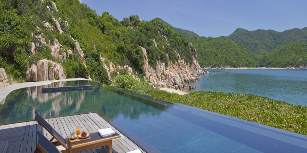 Located on the dramatic coastline of Vinh Hy Bay, Amanoi is a contemporary beachside resort with eleven Guest Pavilions, 18 Villas, two Spa Houses, and five Residences surrounded by the Nui Chua National Park. The resort's Beach Club overlooks a private sandy beach and features a dining area and a swimming pool, while its spectacular Central Pavilion and a second swimming pool are set on a hilltop, offering magnificent sea views.