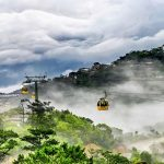 BA NA HILLS CABLE CAR. Ba Na Hill resort and Golden Bridge has been attracting a lot of attention, nestled in Ba Na Hill 1,400 meters (nearly 4,600 feet) above sea level over a 150-meter (nearly 500 feet) deep valley, the bridge looks as if it's supported by two giant hands. It's located in the Truong Son mountain range. Ba Na mountain accommodates resort complex looks like a medieval castle, but between these walls are modern accommodations, world class restaurants and a Fantasy Park.