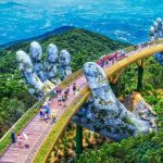 GOLDEN BRIDGE DANANG. Golden Bridge nestled in Ba Na Hill 1,400 meters (nearly 4,600 feet) above sea level over a 150-meter (nearly 500 feet) deep valley,