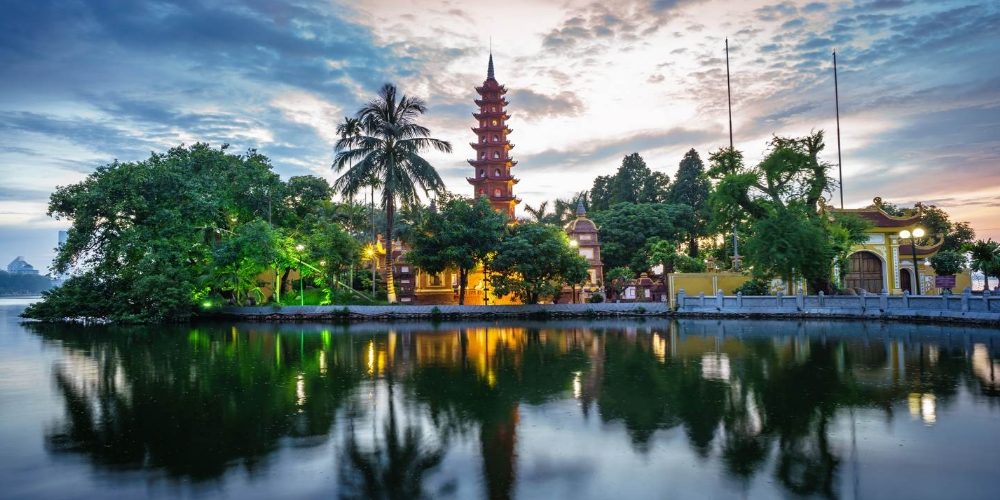 Hanoi is the capital of the Socialist Republic of Vietnam. It's located in the Red River Delta, in the center of North Vietnam. The population in 2015 was estimated at 7.7 million people. The city lies on the right bank of the Red River. Hanoi is 1,760 km (1,090 mi) north of Ho Chi Minh City and 120 km (75 mi) west of Haiphong. Hanoi is a sacred land of Vietnam. In the 3rd century BC, Co Loa (actually belonging to Dong Anh District) was chosen as the capital of the Au Lac Nation of Thuc An Duong Vuong (the King Thuc). Hanoi later became the core of the resistance movements against the Northern invasions.